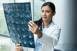 Healthcare woman looking at radiographic image